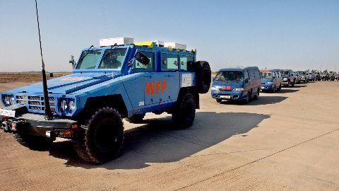 Aid trucks reach besieged Syrian towns